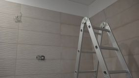 Unfinished bathroom in new house apartment building. Ladder and tiles. Unfinished bathroom in new flat house apartment building. Ladder and electricity cable stock footage