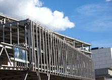Unfinished big industrial building construction. Metal frame mounting Stock Image