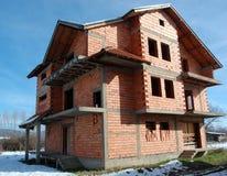 Unfinished brick house Stock Photo