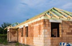 Unfinished brick house stock photos