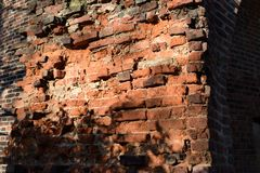 Unfinished brick wall. Red bricks part of an ancient tower Stock Photo
