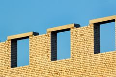 Unfinished brick wall Stock Images
