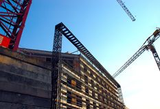 Unfinished Building. And construction crane Royalty Free Stock Photos