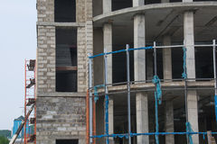 Unfinished Building. Closeup. Unfinished building. Scaffolding at construction site Royalty Free Stock Photos