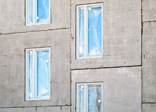 Unfinished building concrete wall with windows Royalty Free Stock Photos