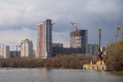 Unfinished Building at Construction Site, view from river. Stock Photos