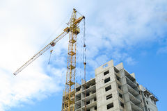 Unfinished building and crane tower during sunrise Stock Photography
