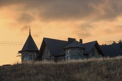 Unfinished building on the hill at sunset. Landscape Royalty Free Stock Photo