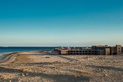 The unfinished building of the hotel on the shores of the Red Sea. In Sharm El Sheikh Royalty Free Stock Photo