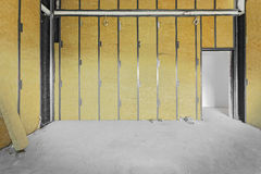 Unfinished building interior. Walls covered with rock-wool Royalty Free Stock Images