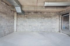 Unfinished building interior. Empty room with conditioning canals Royalty Free Stock Photo