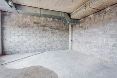 Unfinished building interior. Empty room with conditioning canals stock photos