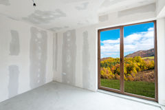 Unfinished building interior (includes clipping path). Unfinished building interior, white room with autumn view (includes clipping path stock photos
