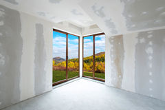 Unfinished building interior (includes clipping path). Unfinished building interior, white room with autumn view (includes clipping path royalty free stock images