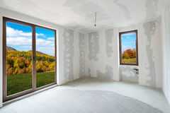 Unfinished building interior (includes clipping path). Unfinished building interior, white room with autumn view (includes clipping path royalty free stock image