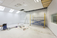 Unfinished building interior. White room stock images