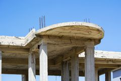 Unfinished building made of concrete slabs. Reinforcing bars and wooden planks Stock Photos