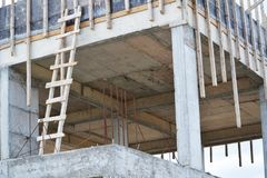 Unfinished building made of concrete slabs. Reinforcing bars and wooden planks Royalty Free Stock Photo