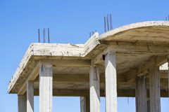 Unfinished building made of concrete slabs. Reinforcing bars and wooden planks Stock Image