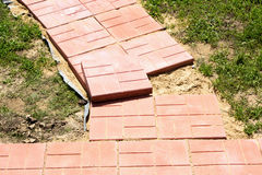 Unfinished building path of red concrete tiles Stock Images