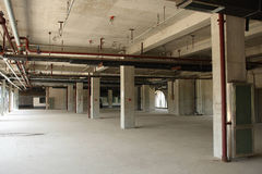 Unfinished building. Pipes on the ceiling Stock Photography