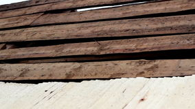 Unfinished cedar wooden shingle shake roofing repair. Unfinished roofing repair. The cedar wooden shingle shake roof is made of wooden roof tiles and some nail stock video