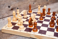 Unfinished chess game on wooden board Stock Photo