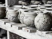 Unfinished clay pots on shelves as part of a ceramic pottery workshop in Marginea, Bucovina, Suceava county, Romania. Unfinished clay pots on shelves as part of Royalty Free Stock Image
