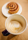 Unfinished coffee and croissant Stock Photo