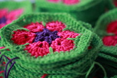 Unfinished crochet African flower hexagons Royalty Free Stock Photography