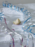 Unfinished cup cake amongst streamers on table elevated view Royalty Free Stock Image