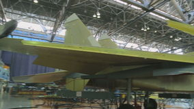 Unfinished fighter is covered with a protective enamel in shop for assembly of aircraft. Fighter is able to effectively solve combat tasks regardless of nature stock video