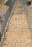 Unfinished gabion cage Royalty Free Stock Images