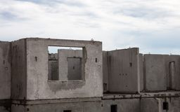 Unfinished grey concrete building in the construction site.  Stock Images