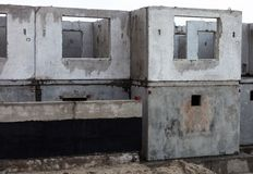 Unfinished grey concrete building in the construction site Stock Photo