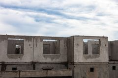 Unfinished grey concrete building in the construction site Stock Photography