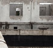 Unfinished grey concrete building in the construction site Stock Image
