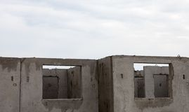 Unfinished grey concrete building in the construction site Royalty Free Stock Images