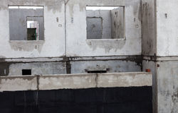 Unfinished grey concrete building in the construction site.  Royalty Free Stock Images