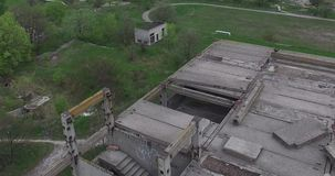Unfinished grey concrete building in the construction site .Drone shots. Unfinished grey concrete building in the construction site stock video