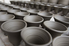 Unfinished handmade pot made of clay Stock Photo
