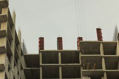 Unfinished high-rise building, crane, architecture. stock photos