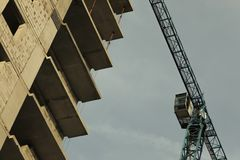 Unfinished high-rise building, crane, architecture. stock photo