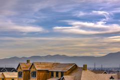 Unfinished homes in Daybreak Utah against mountain stock image