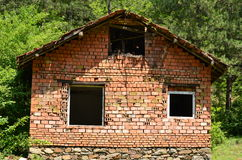 Unfinished house of brick in the forest Stock Photography