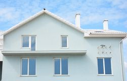 Unfinished house construction with incomplete balcony installation. Photo stock photo