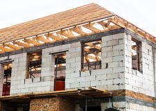 Unfinished house with timber roof truss Royalty Free Stock Photos