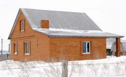 Unfinished house in the village, unit tunes snow. Photographed in Russia, in the countryside Stock Image