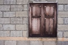 Unfinished house wall wooden window Stock Photos