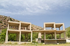 Unfinished illegal building, a construction of armoured concrete. On Preveli beach, Crete, Greece Royalty Free Stock Photography